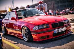 Hellrot BMW E36 coupe slammed on cult classic's OZ AC Schnitzer Type 1 wheels