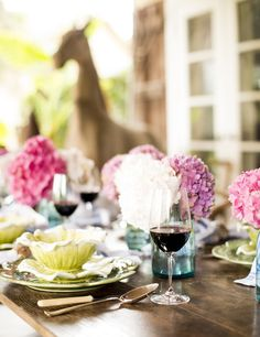 Tablescape - A brown outdoor table with hydrangea and red wine