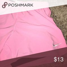 Light pink Nike shorts Shorts in great shape. Worn once.built in spanx are black Nike Shorts