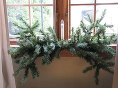 used parts from an old artificial tree as the garland..smart   also, nice idea in this article for using burlap as a table covering....looks great.