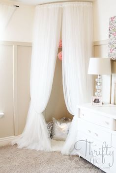 A rounded shower curtain to hang soft curtains around the crib.