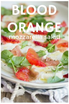 A perfect summer blood orange salad.  Fresh blood orange slices with olive oil, prosciutto and watercress