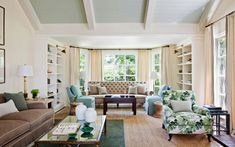 blue, planked ceiling, peter dunham fig leaf fabric + that tufted sofa!
