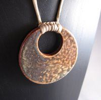 Emily Murphy . . . note how the silk cord is attached to the clay pendant . . .