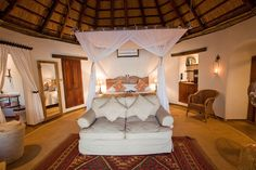 Luxurious sleeping space at the River Cottages, Tongabezi Safari Lodge, Zambia