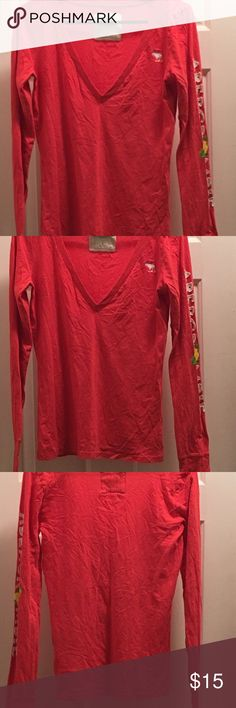 "Abercrombie & Fitch Long-sleeved Tee size M Abercrombie & Fitch Long-sleeved V-neck Tee size Medium. Bright pink with ""Abercrombie"" down the left sleeve. Never worn! Abercrombie & Fitch Tops Tees - Long Sleeve"