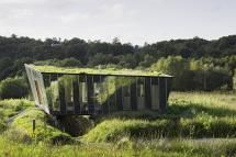 Glass house with green roof blends into the Irish countryside, the Mimetic House by Irish Architect Dominic Stevens, Dromahair, County Leitrim, Ireland, 2006 - Photo by Ros Kavanagh / Corbis Documentary / Getty Images (cropped)