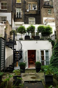 Discover city garden ideas on HOUSE - design, food and travel by House & Garden.The London garden of Oka founder Annabel Astor uses decorative ironwork and low maintenance planting.