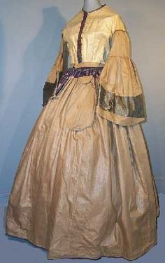 Ca. 1860 violet striped silk dress with large bell sleeves. Body is lined with ecru polished cotton, skirt and sleeves with tan. Sleeves are faced with green silk. Note pocket.