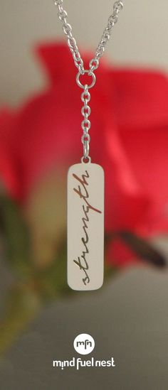"""Give yourself with the courage to move forward with this Y-shaped necklace, designed with a drop pendant that features the word """"Strength"""" in cool cutout script. Meaningful Jewelry, To Move Forward, Inspirational Message, Dog Tag Necklace, Strength, My Love, Pendant, Pendants, Electric Power"""