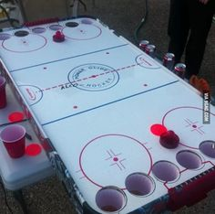 And I present to the world alchohockey, Canadian beer pong.