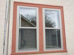 Larson flush mount double hung storm window, sandstone color