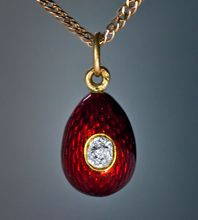 An antique Russian red guilloche enamel and diamond miniature egg pendant by Carl Faberge, jeweler to the Tsars.    Made in St Petersburg between 1899 and 1903.
