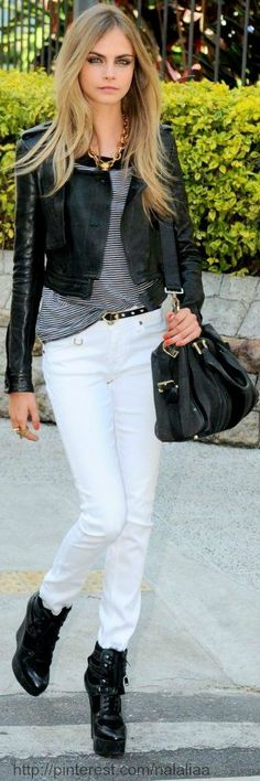 Black ankle boots, white skinny jeans, black and white striped shirt, black leather jacket - Cara Delevingne