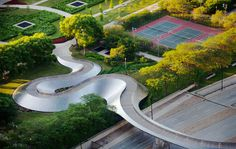 BP Bridge in Chicago - This stainless-steel footbridge—bearing Gehry's signature biomorphic curves—winds its way across Columbus Drive from Millennium Park to Daley Bicentennial Plaza.