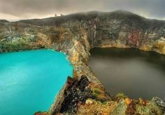 """The haunted Lakes of Mount Kelimutu, Indonesia are considered to be the resting place for departed souls. The lakes are locally referred to as """"The Lake of Evil Spirits"""". All three lakes change color from blue to green to black or red, unpredictably. Places Around The World, Oh The Places You'll Go, Places To Travel, Places To Visit, Around The Worlds, Terre Nature, Beautiful World, Beautiful Places, Amazing Places"""
