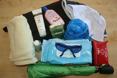 : Blanket :: Umbrella :: Mini first aid kit :: Hand sanitizer :: Sunscreen :: Plastic bags. These are from the grocery store and are great for dirty diapers, outdoor items that suddenly become most cherished treasures, and of course, trash. :: Wipes :: Diaper changing kit (it's a roll out mat that has diapers, cream, and wipes inside of it). :: Sun hats :: Sunglasses :: Kleenex