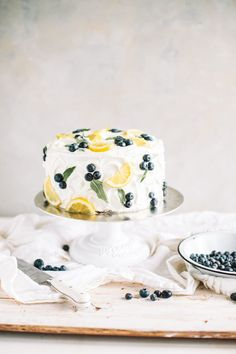 A spring lemon blueberry cake with zesty lemon buttercream! This layer cake is s. A spring lemon blueberry cake with zesty lemon buttercream! This layer cake is studded with contemporary juicy blueberries, stuffed with lemon curd an. Pretty Cakes, Cute Cakes, Gorgeous Cakes, Cake Cookies, Cupcake Cakes, Cream Cookies, Desserts Printemps, Bolo Cake, Torte Cake