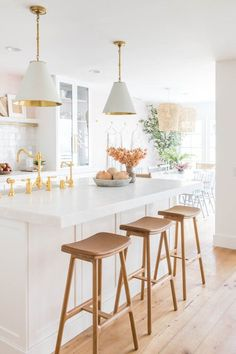 Beautiful all white kitchen with cone pendant lights and extra thick countertop on island - kitchen ideas - kitchen remodel - kitchen lighting - modern kitchen - coastal style Kitchen Stools, Kitchen Dining, Kitchen Decor, Kitchen Ideas, Long Kitchen, All White Kitchen, Beautiful Kitchen Designs, Beautiful Kitchens, Kitchen Island Height