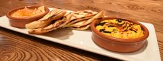 Hummus Duo, traditional with smoked paprika and extra virgin olive oil and roasted butternut squash with black tahini, served with grilled pita | Green Valley Grill | Greensboro, NC