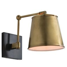 """A sophisticated sconce for modern walls, the Arteriors Watson fixture features a sleek combination of brass and bronze. This angled accent sheds light on favorite art pieces, elegant bedsides, and contemporary powder rooms with polished panache. 14.5""""-20"""" Adjustable Depth. 8.5""""W x 10""""H. Steel. Hardwired. Assembly required. Accepts one E-26 60W bulb (not included)."""