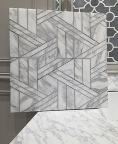 Art Deco marble pattern   Renaissance Tile and Bath. Calacatta water-jet mosaic.