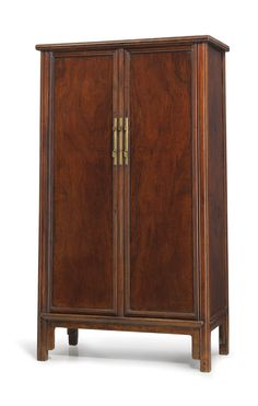 A huanghuali sloping-stile wood-hinged cabinet, late Ming dynasty.