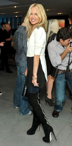 Rachel Zoe in tall black over the knee boots with skinnys