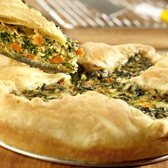 Rustic Spinach Pie Looking for an appetizing, meatless main dish? Try this quiche-like spinach pie in a puff pastry crust, that gets extra flavor from feta cheese and dry onion soup mix. Puff Pastry Recipes, Pie Recipes, Whole Food Recipes, Cooking Recipes, Puff Pastries, Veggie Recipes, Vegetarian Recipes, Savoury Recipes, Recipes