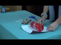 Gift wrapping can be so frustrating sometimes. If it's not a box, it can end up in disaster. Professional gift wrapper Jane Means has a helpful video on how to wrap up cylinder-shaped presents, one of the trickiest kinds to deal with. Watching her do it is actually very mesmerizing, so take a look!