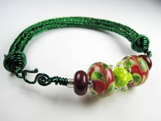 Red  Green Lampwork Glass on Green Viking Knit Bracelet | EntwinedVines - Jewelry on ArtFire