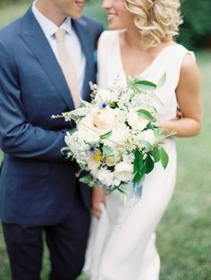 The blue accents between the couple are gorgeous!