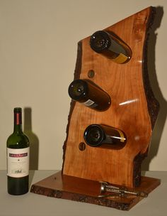Williams Creation's by ATWilliams Log Projects, Projects To Try, Wine Holders, Wine Stand, Cellar Ideas, Creation Homes, Live Edge Furniture, Wine Shelves, Woodworking Projects That Sell