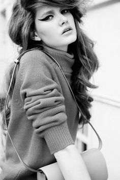 Love the big hair and major eyeliner. The knit wool pullover is by Jil Sander.