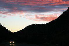 Headlights. Mountain sunset