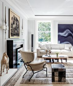 Welcome to the home of collector Stacy Bronfman. This simple, clean design by Jacques Granges allows the art to speak for itself. French Interior, Interior Design, Interior Architecture, Living Room Lounge, Living Rooms, Piece A Vivre, Fireplace Design, Home And Deco, Clean Design
