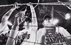 Cutting off a piece of the net after winning NCAA D1 championship