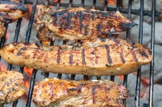 marinated chicken pieces cooking on the grill
