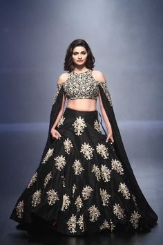 If you are aiming for that showstopper look at your sisters wedding, then this cape style black lehenga from SVA is the perfect sister of the bride look for you. #frugal2fab