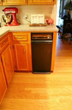 Have an outdated appliance? Just buy an appliance spray paint can for a couple of bucks and you get a whole new look! Check out how I took a pea green trash compactor to a nice black.   www.rappsodyinrooms.com #spraypaint #diy