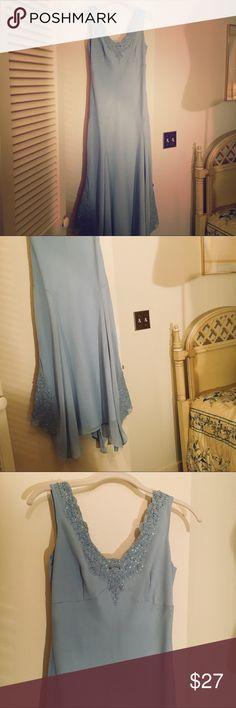 Powder Blue Evening Wear Powder Blue Dress with beaded neck and hemlines. Irregular, flouncy skirt. Size 4. Dresses Prom