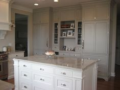 the wall color is BM Edgecomb gray. the white cabs are BM white dove, and the gray ones are BM Stone harbor gray.
