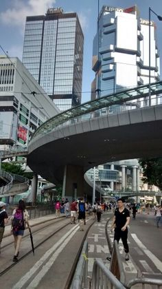 Outside the Bank of China Tower, Hong Kong. In the background are the landmark towers of the Lippo Center.