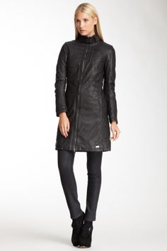 """Leather Coat in solid black by Emporio Armani $1475 - $429 @HauteLook. - Stand-up collar with detachable snap button closure - Front zip closure - Front chest pocket with zip closure - 2 front slit side pockets with snap button closure - Patchwork construction - Padded  - Approx. 36"""" length  Model's stats: - Height: 5'11"""" - Bust: 34"""" - Waist: 24"""" - Hips: 35""""  Model is wearing size 38. Fabric 1: 100% sheepskin. Fabric 2: 98% polyester, 2% elastane. Lining: 100% viscose . Padding: 100%…"""