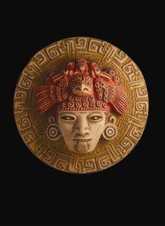AZTEK KARTAL MASKESİ A-004     21,5 x 21,5 x 7 cm.     Tören ve seremonilerde kullanılmakta ve çeşitli doğa güçlerine adanmaktaydı. Uygarlıklar Atölyesi