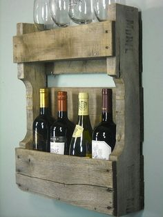 Drill holes for the bottle's neck and put them in upside down. That will protect the cork from drying out. Maybe trim or remove the bottom board after that so you can still see the labels.