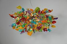 Hanging chandeliers. Colorful flowers and leaves. by yehudalight