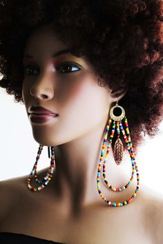 I love how big these are - I think they would be great to break up a neutral, monochromatic palette. African Earrings African Beaded Earrings Tribal by AfriqueLaChic, $30.00