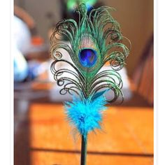 Peacock Feather Pen Note to self: about the curled peacock feather as fan adornment.
