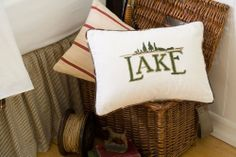"""Lake Hand Embroidered Pillow by Taylor Linens. $61.00. Quick Ship13"""" x 20""""Complete your outdoors themed boy's room decor with this Elk River Trout Boudoir Pillow featuring embroidered details.  Offering exquisite linens since 1922 when the founder started importing damask linens from Ireland, today these designers pride themselves on the craftsmanship of yesterday but with the needs of today. Even the smallest details are not ignored, making each piece of linen one-of-a..."""